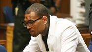 Chris Brown's probation revoked: 'My cross is heavy,' he tweets
