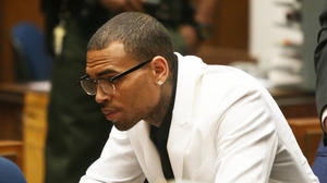 Chris Brown's probation revoked: 'My cross is heavy,' he tweets