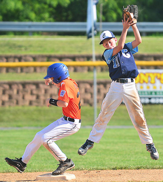 Easton's Alexander Stecher-Scott makes it onto second base as Conococheague's Justin Moschel jumps to catch the ball Monday in the 10-11 Little League state tournament at Williamsport.