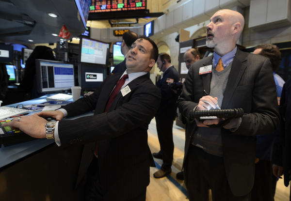 Paul Cosentino, left, of Goldman Sachs and Patrick Armstrong of Prime Executions work on the floor of the New York Stock Exchange, in New York.