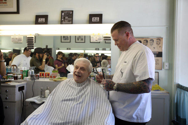 Writer Harlan Ellison has his hair cut at Sweeney Todd's Barber Shop before his Hollywood book signing.