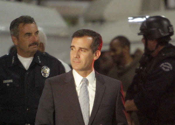 L.A. City Mayor Eric Garcetti arriving in Leimert Park with Los Angeles Police Department Chief Charlie Beck for a press conference.