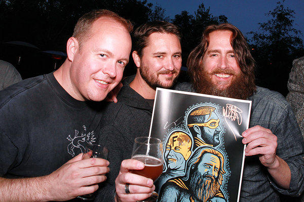 Drew Curtis, Wil Wheaton and Greg Koch with a poster for their new beer.
