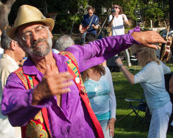 Laguna resident Robert Gluckson dances to Beatles tribute band Beatroots on Sunday duirng the city's Music in the Park concert.