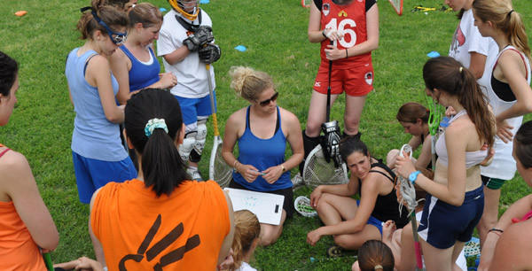Towson native Anna Sody (center with clipboard) gives instructions during a team camp in Milan, Italy.