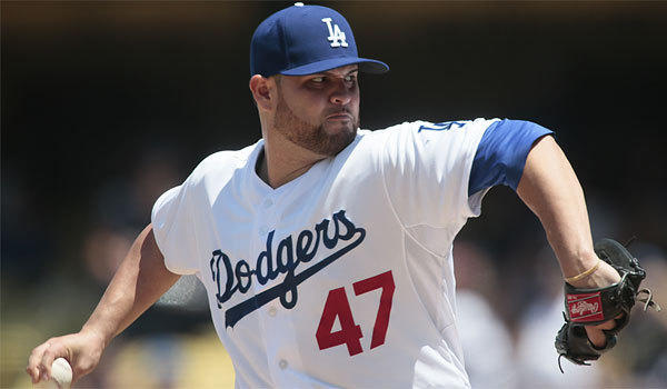 Dodgers pitcher Ricky Nolasco throws against the Colorado Rockies on Sunday.
