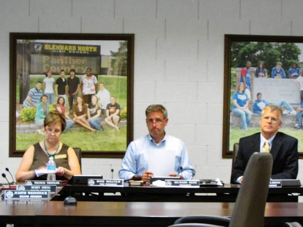 Glenbard District 87 School Board Vice President Rose Malcolm, President Richard Heim and Superintendent David Larson listen during Monday's meeting.