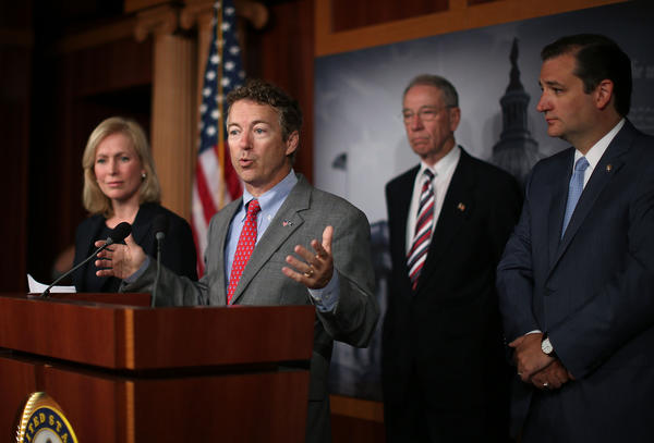 Sen. Rand Paul (R-KY) (C) speaks while flanked by Sen. Kirsten Gillibrand (D-NY) (L) Sen. Charles Grassley (R-IA) (2nd-R) and Sen. Ted Cruz (R-TX) (R) during a news conference on sexual assault in the military.