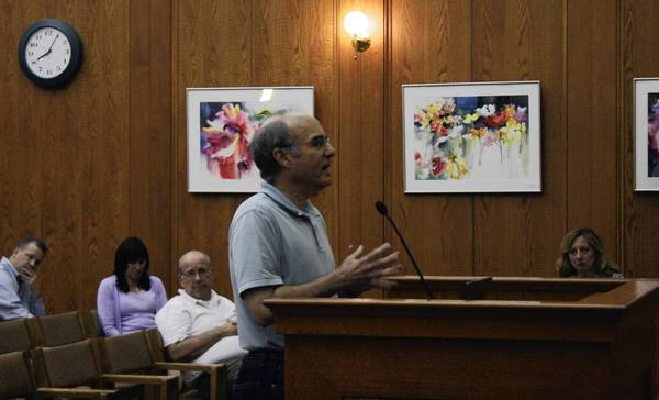 Northbrook resident Lee Goodman urges Northbrok's village trustees to pass a local assault weapons ban on June 11 at the Village Hall.