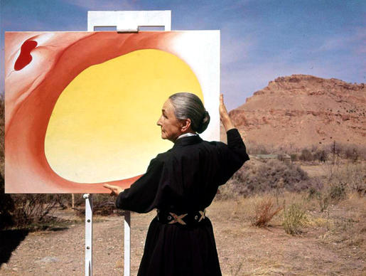 Georgia O'Keeffe, pictured with a canvas in 1960, is known for her paintings of the Southwest.
