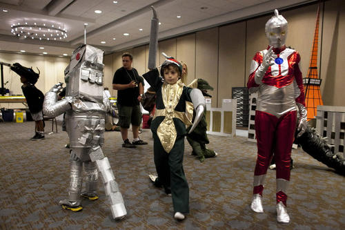 Children wait to march in the costume parade during G-Fest XX at the Crown Plaza hotel July 13, 2013 in Rosemont, Ill. G-Fest is one of the largest gatherings of Godzilla and Japanese monster fans in the world, held every summer for the last 20 years.