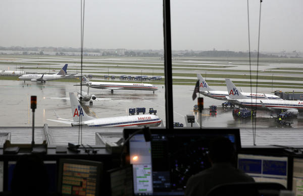 Workers navigate planes from the American Airlines Ramp Tower at Terminal 3 at O'Hare International Airport in Chicago.