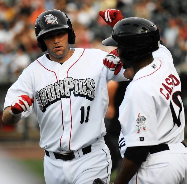 IronPigs' Cody Overbeck (11) celebrates a home run with Leandro Castro (18). The Lehigh Valley IronPigs played the Toledo Mud Hens at Coca-Cola Park in Allentown Monday July 1, 2013.