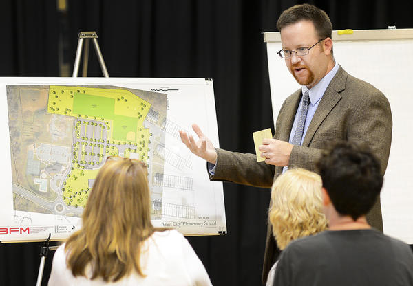 "Aaron K. House, project architect for Bushey, Feight, Morin Architects Inc., showed possible designs for ""West City"" elementary school Tuesday night at Salem Avenue Elementary School."