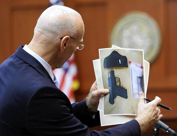 Don West, a lawyer for George Zimmerman, holds an evidence photo in the trial. Zimmerman was acquitted in Trayvon Martin's slaying partly because Florida laws in close-call cases like this one give an edge to the shooters.