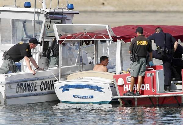 Orange County Sheriff's Harbor Patrol tries to convince a man wanted for boat theft to surrender in a stolen Duffy electric boat during an hour-long slow-speed pursuit through Newport Harbor in Newport Beach on Tuesday.