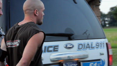 James Betz is escorted to an interview after his arrest Tuesday evening.
