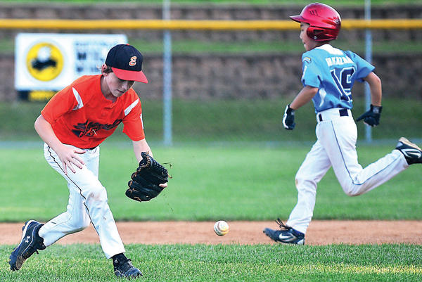 Easton's Alexander Stecher-Scott tries to make a play as Bethesda's Harufumi Nakazawa runs for second Tuesday during the Little League 10-11 State Tournament at Conococheague's Ebersole field in Williamsport.