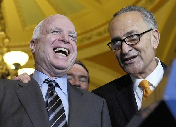 Sens. John McCain (R-Ariz.), left, and Charles E. Schumer (D-N.Y.) spent days negotiating a plan to end the filibuster standoff in the Senate.
