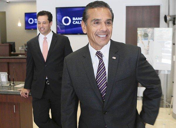 Antonio Villaraigosa and Banc of California CEO Steven Sugarman, left, are shown on Tuesday. Villaraigosa said he was intrigued by the opportunity to figure out how to provide greater access to home loans in communities hit hard by the recession.