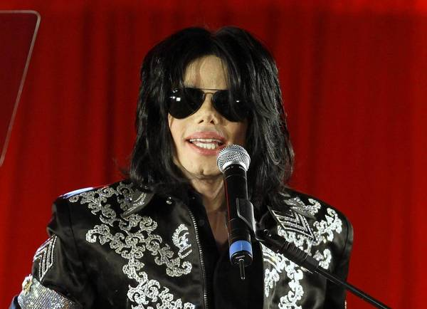 """Michael Jackson, shown in March 2009, announces his 50-show """"This Is It"""" comeback concerts set for July of that year at London's O2 Arena. His mother and children have filed a wrongful-death suit against concert promoter AEG Live."""