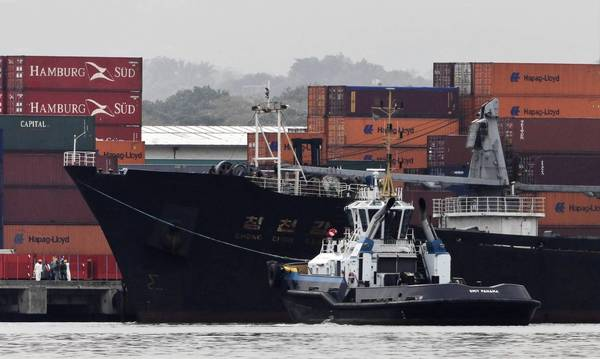 The North Korean-flagged cargo ship Chong Chon Gang, center, sits docked at Colon, Panama.
