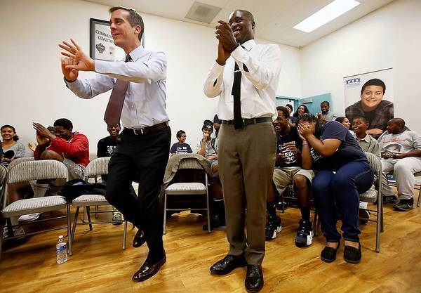Los Angeles Mayor Eric Garcetti concludes a meeting with young residents of South Los Angeles on Tuesday.