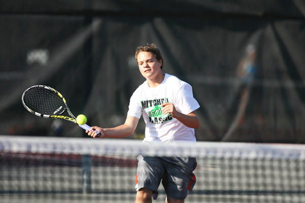 Matt Hollan of Aberdeen comes to the net to hit a forehand volley during his boys 14 singles championship victory at the C.C. Lee Open Tennis Tournament at the NSU Courts on Tuesday morning. Hollan also added the boys 18 doubles title to his resume.