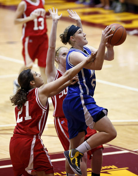Chynna Stevens, of Clark and the North All-Stars goes to the basket between South All-Stars Kendra Cheeseman, of Alexandria (21) and Kelsey Fitzgerald, of Yankton, behind Stevens, during Tuesday night's girls basketball game at Wachs Arena.