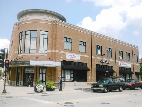 Second-story businesses located in a former Borders store in downtown La Grange were ordered to take down temporary second-story signs this week.