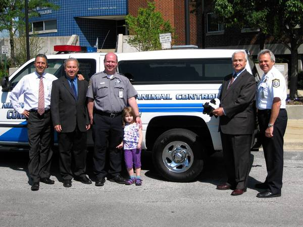 Left to right: Niles Village Trustee George D. Alpogianis; Trustee John C. Jekot; Animal Control Officer Peter Babikan; Mayor Andrew Przybylo; and Police Chief Dean Strzelecki pose for a picture after announcing the return of Babikan to Animal Control officer.
