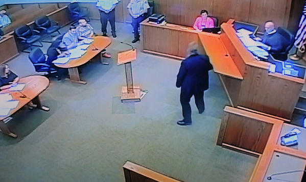 In this photo from a video monitor at the Union County Courthouse in Jonesboro, Ill., Anthony Garcia, in striped shirt, a doctor from Indiana who is a suspect in four killings in Nebraska, sits with attorneys during his extradition hearing before Judge Mark Boie, right, on Wednesday. Garcia waived extradition and will return to Omaha to face murder charges. Garcia, who lives in Terre Haute, Ind., was arrested Monday in Union County in southern Illinois.