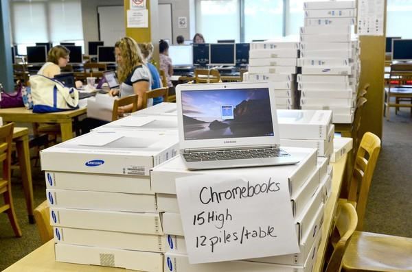 When students return to Manchester High School this fall they'll each be receiving a brand new Google Chromebook to use. So far, there are 250 laptops awaiting students. Stacks of the devices in the school's library resemble pizza boxes.