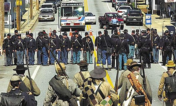 -..-Traffic is halted as the Union and Confederates prepare to battle on Main St in Funkstown-..-Traffic is halted on Baltimore Street in Funkstown as re-enactors portray the Battle of Funkstown. A total of 481 soldiers were killed or wounded in the original, daylong battle on July 10, 1863, during the War Between the States.