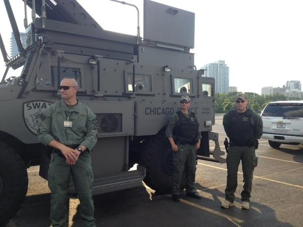 John Hroma, a member of the Chicago Police Department's Special Weapons and Tactics (SWAT) team, discusses police work in front of an armored SWAT vehicle July 16, 2013 in Chicago (Rachel Cromidas/RedEye).