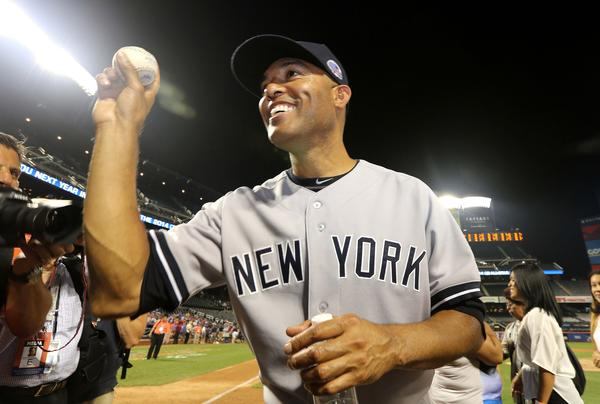 Jul 16, 2013; Flushing , NY, USA; American League pitcher Mariano Rivera (42) of the New York Yankees holds up a game ball as he walks off the field following the 2013 All Star Game at Citi Field. Mandatory Credit: John Munson/THE STAR-LEDGER via USA TODAY Sports ORG XMIT: USATSI-134232