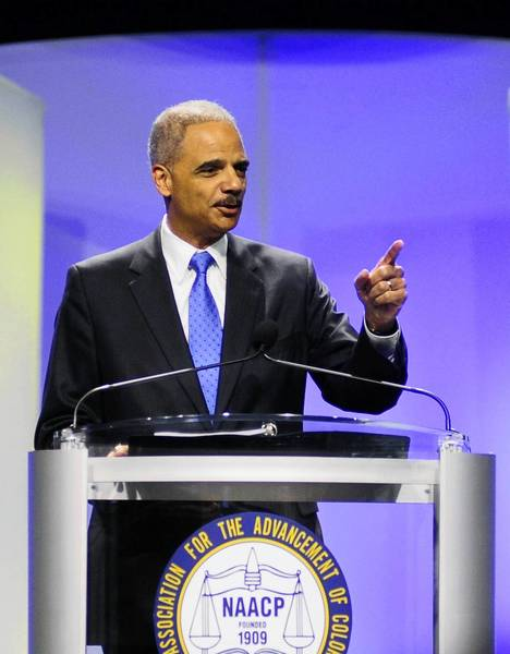 U.S. Attorney General Eric Holder speaks at the annual convention of the National Association for the Advancement of Colored People in Orlando, Fla., on Tuesday.