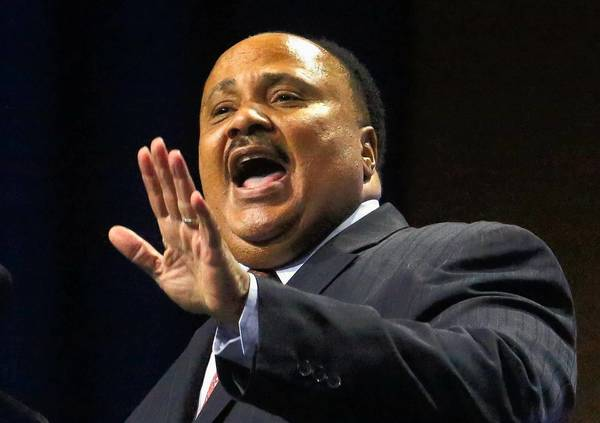 "Martin Luther King III tells an NAACP convention crowd Wednesday that ""the dream of my father has not been fulfilled."" He called the George Zimmerman verdict ""a wake-up call."""