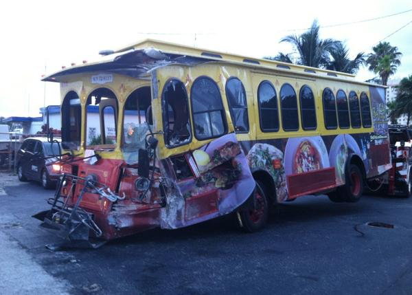 Five people were hurt when a beach trolley bus jumped the curb and hit a building in Fort Lauderdale.