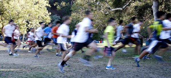 Over 50 runners (shown through a long exposure) from throughout the area and beyond took part in the first of three races of the Crescenta Valley Park Cross-Country Summer Series at La Crescenta Park on Wednesday. (Tim Berger/Staff Photographer)