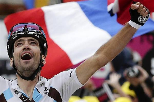 Riblon of France celebrates as he wins the 172.5km eighteenth stage of the centenary Tour de France cycling race from Gap to l'Alpe d'Huez, in the French Alps.