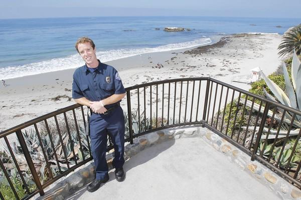 Jeremy Frimond stands above Main Beach. Frimond was chosen as the city's new marine protection officer and will patrol the coves and beaches.