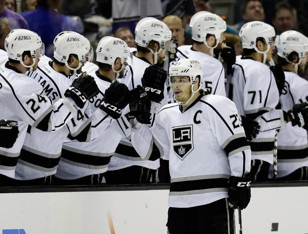 Kings captain Dustin Brown signed on for another eight years with the team Thursday.