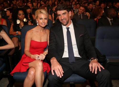 Yes, Michael Phelps has a new love interest. <br><br> Phelps, 28, stepped out with date Win McMurry, also 28, at Wednesday's ESPY Awards, and we're naturally curious about her. We're assuming you are, too. The pair has reportedly been dating since June. <br><br> Here's 10 things to know about the Phelps' new lady. <i>--By Jordan Bartel</i>