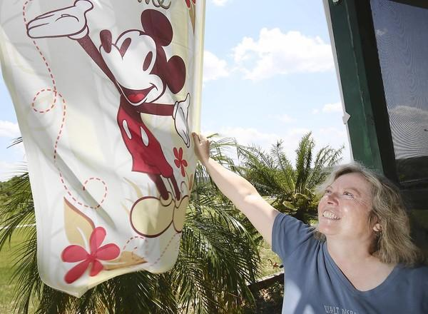 Joan Doyle, who loves Disney, is pictured at her Clermont home on Friday, May 24, 2013.