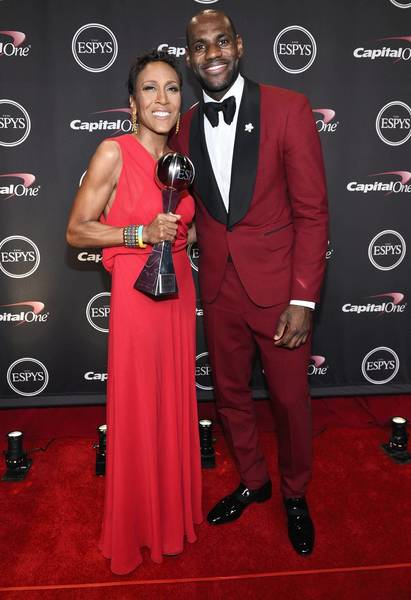 TV personality Robin Roberts, recipient of the Arthur Ashe Courage Award, and NBA player LeBron James pose backstage at the ESPY Awards.
