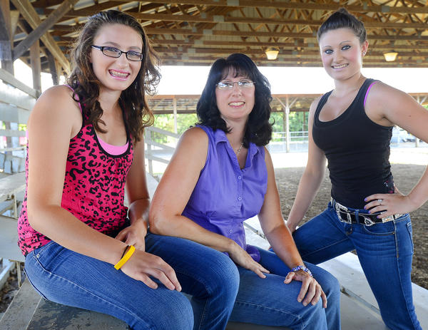 Shawna Corbett, center, and her daughters, Erin, 16, left, and Kaitlyn, 20, right, have been attending the fair since Kaitlyn was a child.