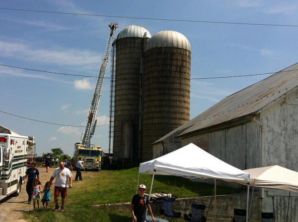 Rescuers use a ladder truck in an attempt to rescue a young person trapped in a silo on Lehmans Mill Road on Tuesday morning.