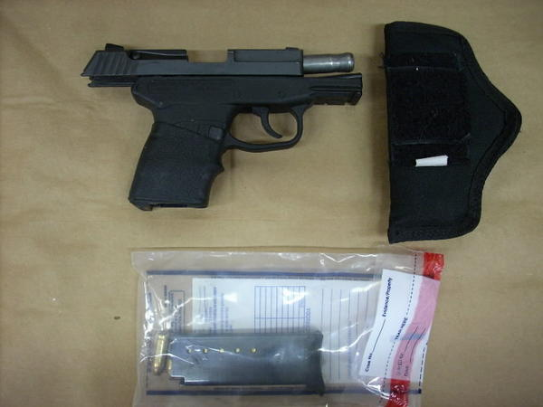 This evidence photo released by the Fourth Circuit Court State Attorney's Office shows George Zimmerman's gun, which was used in the shooting death of Trayvon Martin.