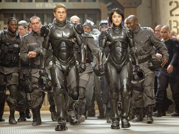 "Charlie Hunnam as Raleigh Becket and Rinko Kikuchi as Mako Mori in Warner Bros. Pictures' sci-fi action adventure movie ""Pacific Rim."""